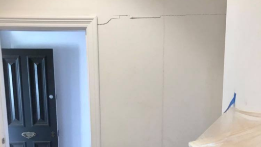 Cracked door frame and wall