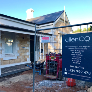 Heritage style home under construction. There is a temporary fence in front of the home with signage that reads 'allenCO construction'.