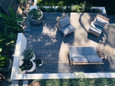 Aerial photo of an outdoor deck style with outdoor lounges and potted plants